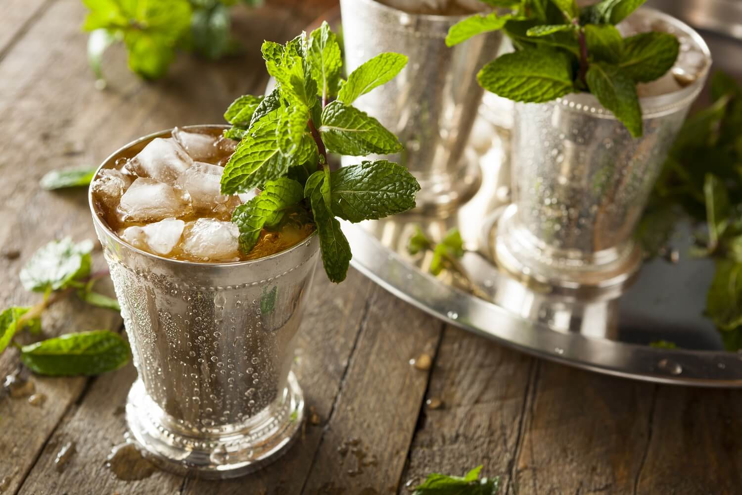 A tray of pre-made mint julep whisky highball