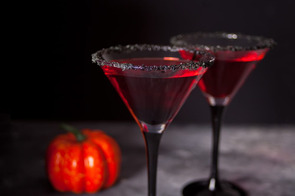 Two halloween cocktails in martini glasses
